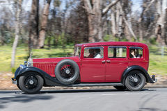 1925 Rolls Royce Phantom driving on country road Stock Photography