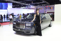 Rolls Royce Phantom Extended Wheelbase  car with Unidentified model on display Royalty Free Stock Image