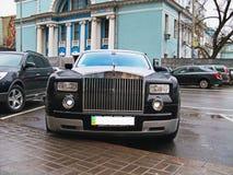 Kiev, Ukraine, 11 March; Rolls-Royce Phantom in the rain drops. It`s raining. Rolls-Royce Phantom in the rain drops. It`s raining stock photo
