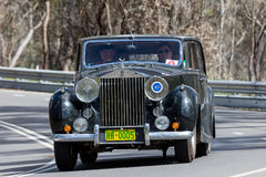 1951 Rolls Royce Silver Wraith Limousine. Adelaide, Australia - September 25, 2016: Vintage 1951 Rolls Royce Silver Wraith Limousine driving on country roads Stock Images