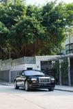 Rolls-Royce Wraith with house Royalty Free Stock Photos