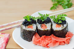 Rolls with salmon, caviar and pickled ginger Royalty Free Stock Photo