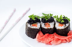 Rolls with salmon, caviar and pickled ginger Royalty Free Stock Photos