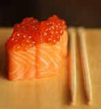 Rolls with salmon and red caviar Royalty Free Stock Images