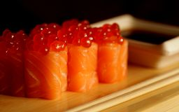 Rolls with salmon and red caviar stock photography