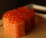 Rolls with salmon and red caviar stock photos