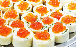 Rolls with salmon roe on a dish Royalty Free Stock Photography