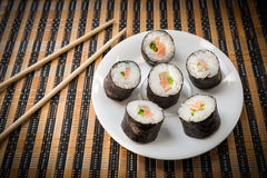 Rolls with salmon in white dish. Stock Photos