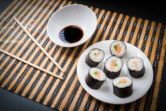 Rolls with salmon in white dish. Stock Images