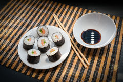 Rolls with salmon in white dish. Stock Image