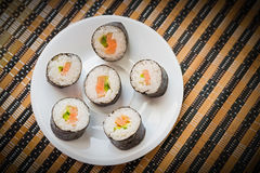 Rolls with salmon in white dish. Royalty Free Stock Image
