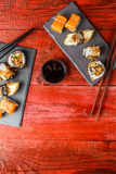 Rolls served at red table Stock Photography