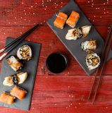 Rolls served at red table Royalty Free Stock Photos