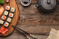 Rolls set and sushi with shrimp served on wooden plate Royalty Free Stock Photos