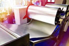Rolls of sheet metal on industrial equipment royalty free stock photo