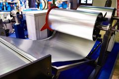 Rolls of sheet metal on industrial equipment stock photography