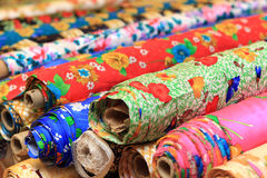 Rolls of silk in shop Stock Photography
