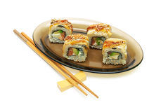 Rolls with smoked eel, salmon and avocado  on white back Stock Photography