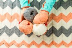 Rolls of soft knitting yarn, knitting, female hands Stock Images