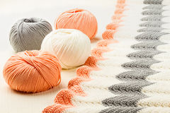 Rolls of soft knitting yarn and knitting Stock Photos