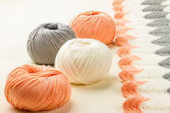 Rolls of soft knitting yarn and knitting Royalty Free Stock Photography