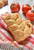 Rolls som är välfylld med tomater och ost Royaltyfria Bilder
