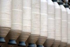 Rolls of spun cotton in a textile factory Stock Photos