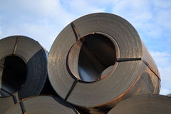 Rolls of steel sheet for cargo. Black rolls of steel sheet for transportation Stock Photo