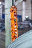 Rolls of steel sheet orange remote control. Close up image Stock Photo