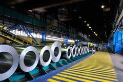 Rolls of steel sheet in a warehouse. Rolls of steel sheet in industrial warehouse Royalty Free Stock Photos