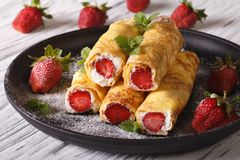 Rolls with strawberry and cream cheese close-up. Horizontal Royalty Free Stock Images