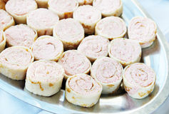 Rolls with stuffing made of butter and seafoods Stock Image