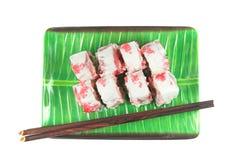Rolls su un piatto con i bastoni Fotografia Stock