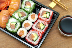 Rolls and sushi on a bamboo board close-up. Royalty Free Stock Photos