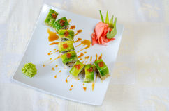 Rolls, sushi and ginger. On a white plate and a light background Stock Image