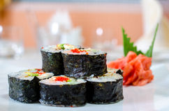 Rolls, sushi and ginger. On a white plate and a light background Stock Photo