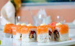 Rolls, sushi and ginger. On a white plate and a light background Stock Photography