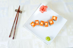 Rolls, sushi and ginger. On a white plate and a light background Stock Photos