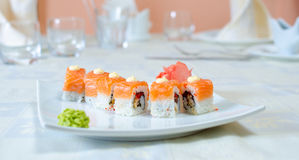 Rolls, sushi and ginger. On a white plate and a light background Royalty Free Stock Images