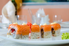 Rolls, sushi and ginger. On a white plate and a light background Royalty Free Stock Photos
