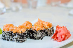 Rolls, sushi and ginger. On a white plate and a light background Royalty Free Stock Photo