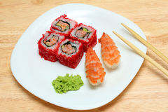 Rolls and sushi on plate Royalty Free Stock Photography
