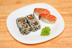 Rolls and sushi on plate Stock Photography