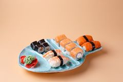 rolls and sushi on a plate in the form of fish Royalty Free Stock Photo