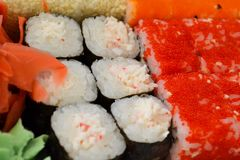 Rolls, sushi set in plastic packaging, close up royalty free stock photography