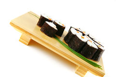 Rolls of sushi on wood Stock Image
