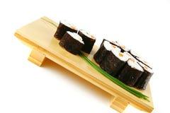 Rolls of sushi on wood Stock Image