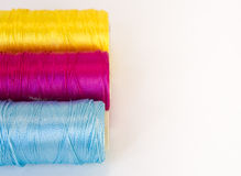 Rolls of thread with CMYK colors. Stock Image