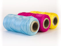 Rolls of thread with CMYK colors. Royalty Free Stock Photos