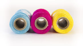 Rolls of thread with CMYK colors. Stock Photo